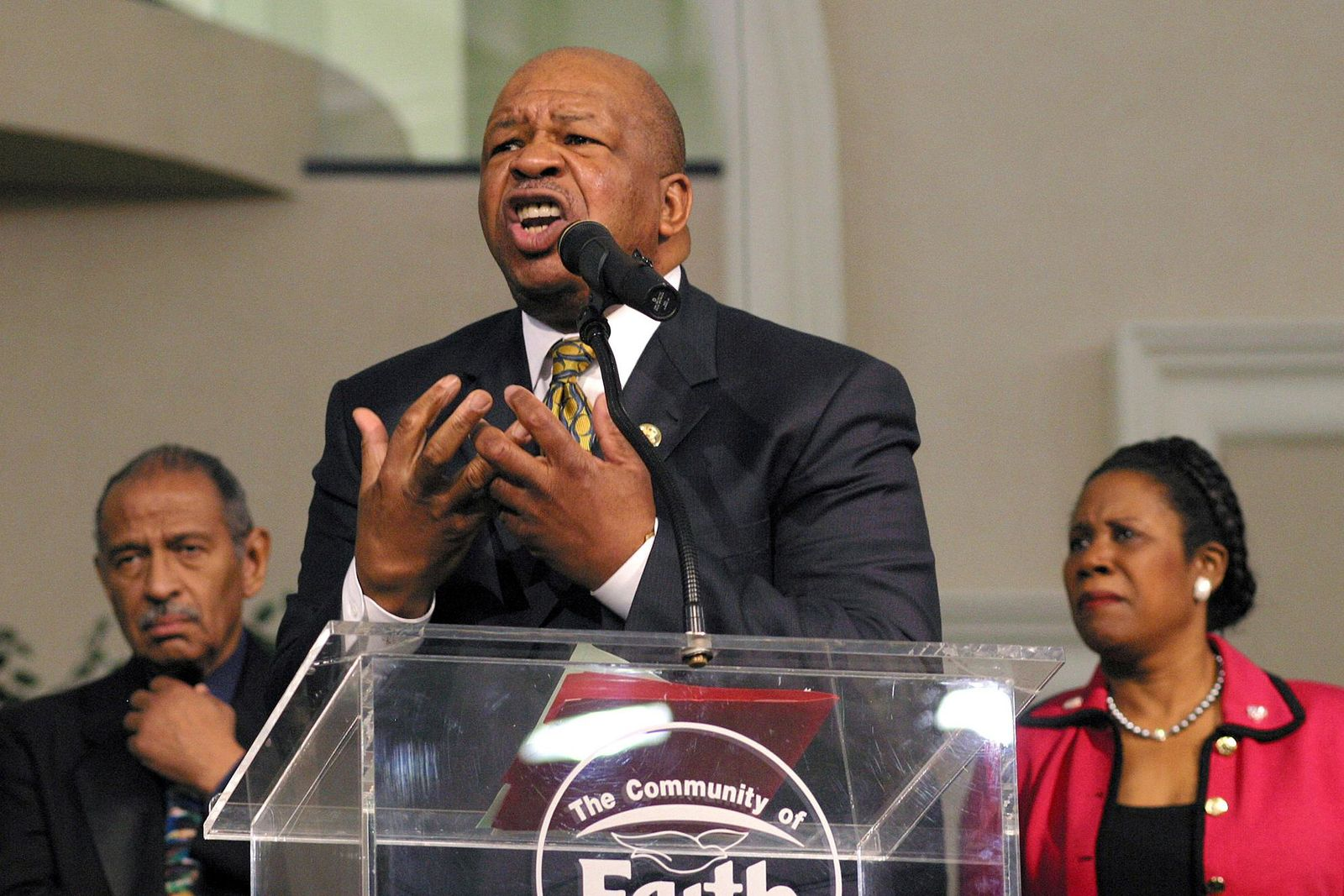 "FILE - In this Sunday, March 30, 2003 file photo, Congressional Black Caucus Chairman Rep. Elijah Cummings, D-Md., speaks about affirmative action, accompanied by Rep. John Conyers, D-Mich., left, and Rep. Sheila Jackson Lee, D-Texas, right, during a church service at Community of Faith Church in Houston. ""Although Congressman Cummings was not a preacher in the sense of being ordained and licensed, him being a preacher's kid made him pretty close and made him very comfortable with ministers and clergy _ to a point where in many respects many of us in the clergy community, in the African-American community, almost regarded him as a preacher,"" said the Rev. Charles Williams II, senior pastor of Detroit's Historic King Solomon Missionary Baptist Church. (AP Photo/Michael Stravato)"