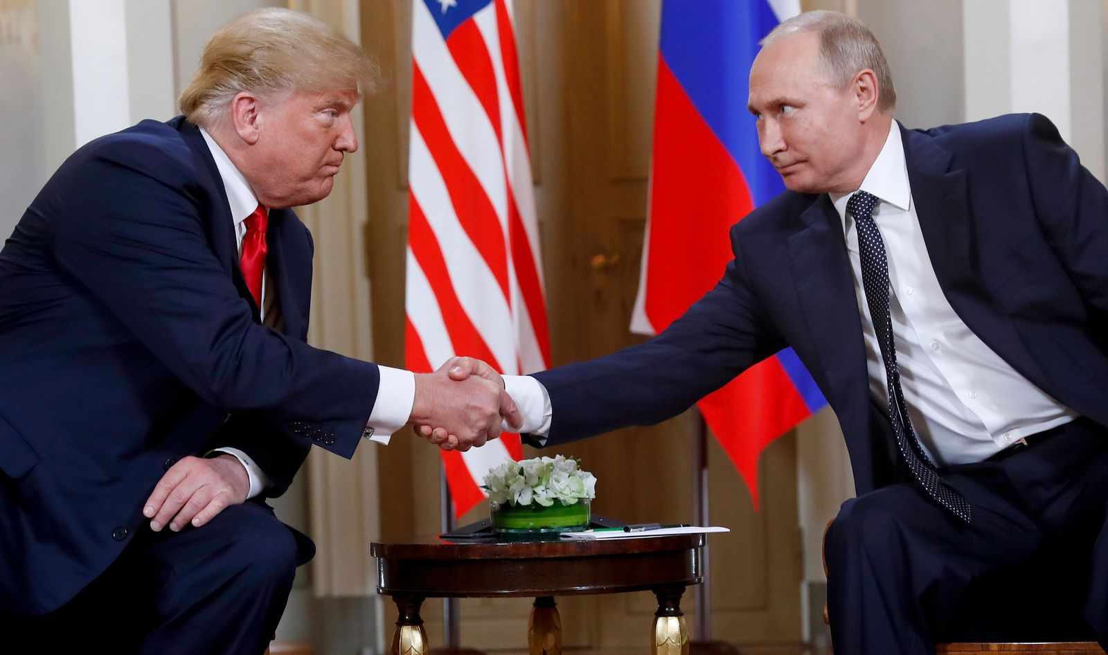 U.S. President Donald Trump, left, and Russian President Vladimir Putin shake hands at the beginning of a meeting at the Presidential Palace in Helsinki, Finland, on July 16, 2018. (AP Photo/Pablo Martinez Monsivais)