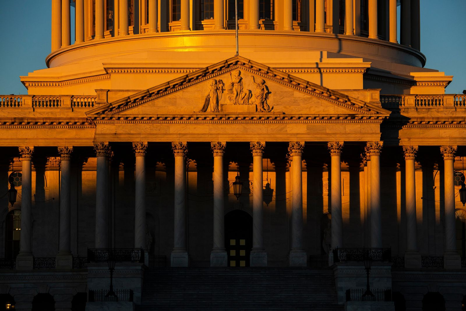 The Capitol is seen at dawn on the 21st day of a partial government shutdown as an impasse continues between President Donald Trump and Democrats over funding his promised wall on the U.S.-Mexico border, in Washington, Friday, Jan. 11, 2019. (AP Photo/J. Scott Applewhite)