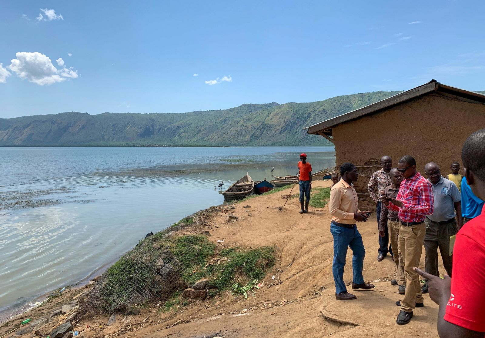 This photo taken Thursday, April 18, 2019 and released by the International Rescue Committee (IRC), shows the shores of Lake Albert near the border with Congo, at Kabakanga in Kagadi district, western Uganda. (Ben Wise/International Rescue Committee via AP)