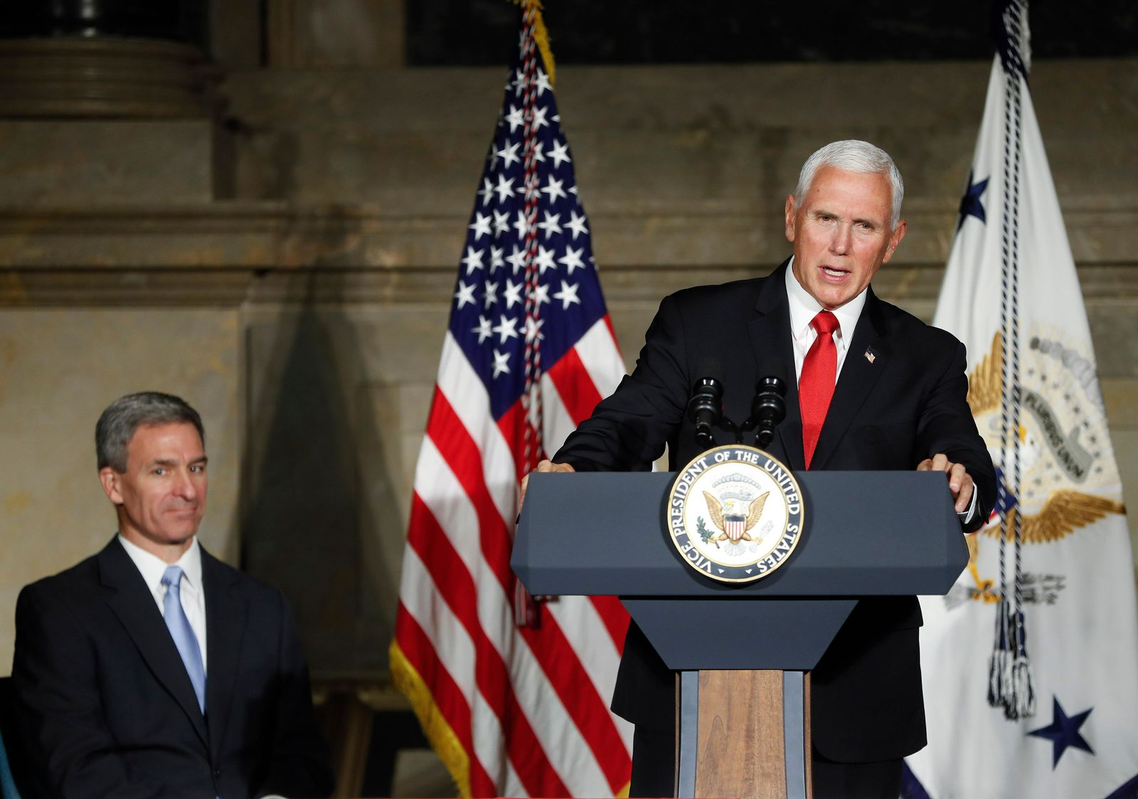 FILE - In this July 4, 2019 photo, Vice President Mike Pence speaks at a naturalization ceremony for new naturalized citizens in celebration of Independence Day at the National Archives in Washington. Trump administration rules that could deny green cards to immigrants if they use Medicaid, food stamps, housing vouchers or other forms of public assistance are going into effect.  (AP Photo/Pablo Martinez Monsivais)