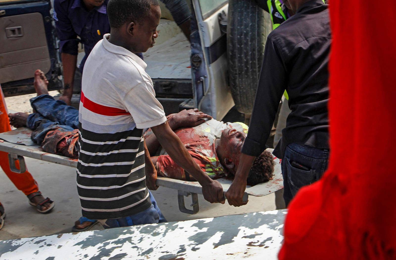Medical workers help a man who was wounded in a bomb attack, at a hospital in the capital Mogadishu, Somalia, Saturday, June 15, 2019. (AP Photo/Farah Abdi Warsameh)