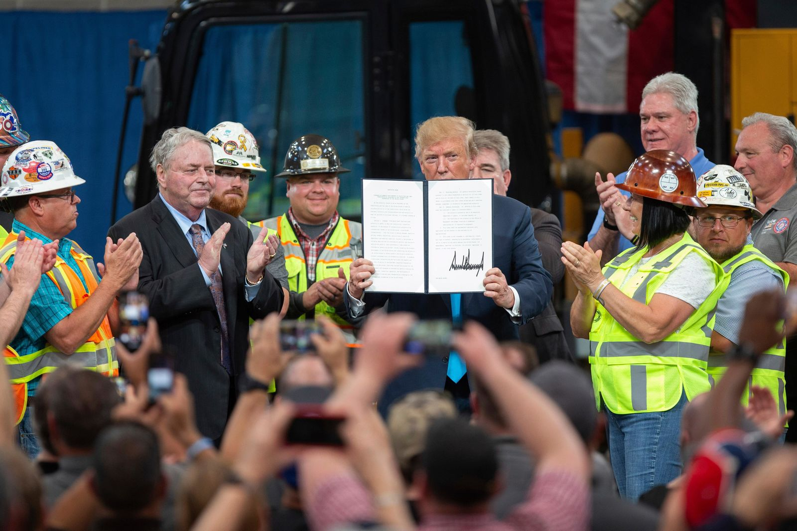 FILE - In this April 10, 2019, file photo, President Donald Trump holds up an executive order on energy and infrastructure after signing it at the International Union of Operating Engineers International Training and Education Center in Crosby, Texas. Trump is now three for three. Each year of his presidency, he has issued more executive orders than did former President Barack Obama during the same time-span. (AP Photo/Juan DeLeon, File)