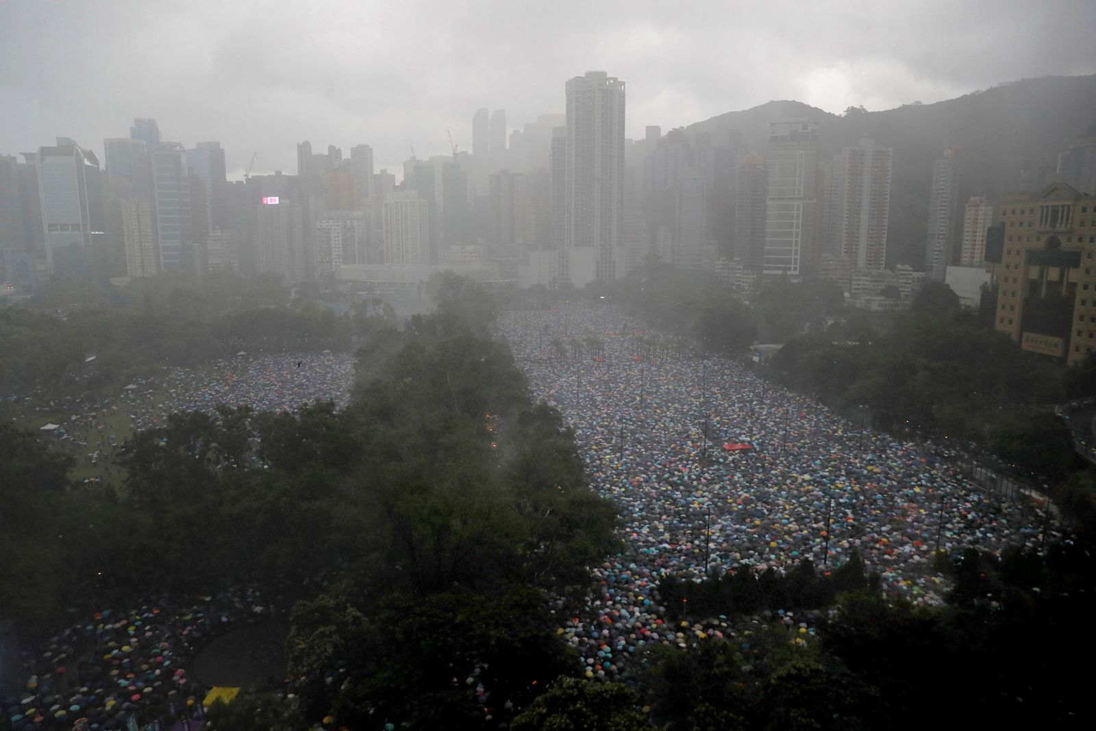 Protesters gather on Victoria Park in Hong Kong Sunday, Aug. 18, 2019.{ } (AP Photo/Kin Cheung)