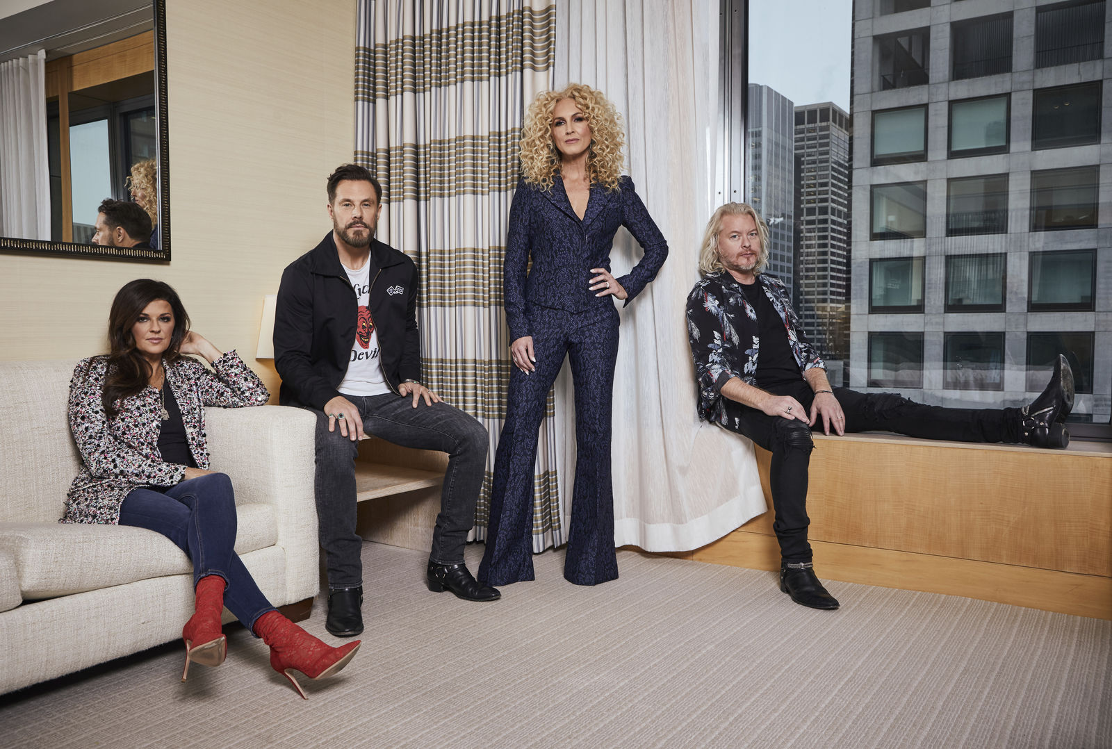 "This Jan. 13, 2020 photo shows members of the country group Little Big Town, from left, Karen Fairchild, Jimi Westbrook, Kimberly Schlapman and Phillip Sweet posing for a portrait in New York to promote their new album ""Nightfall,"" out on Friday.  (Photo by Matt Licari/Invision/AP)"
