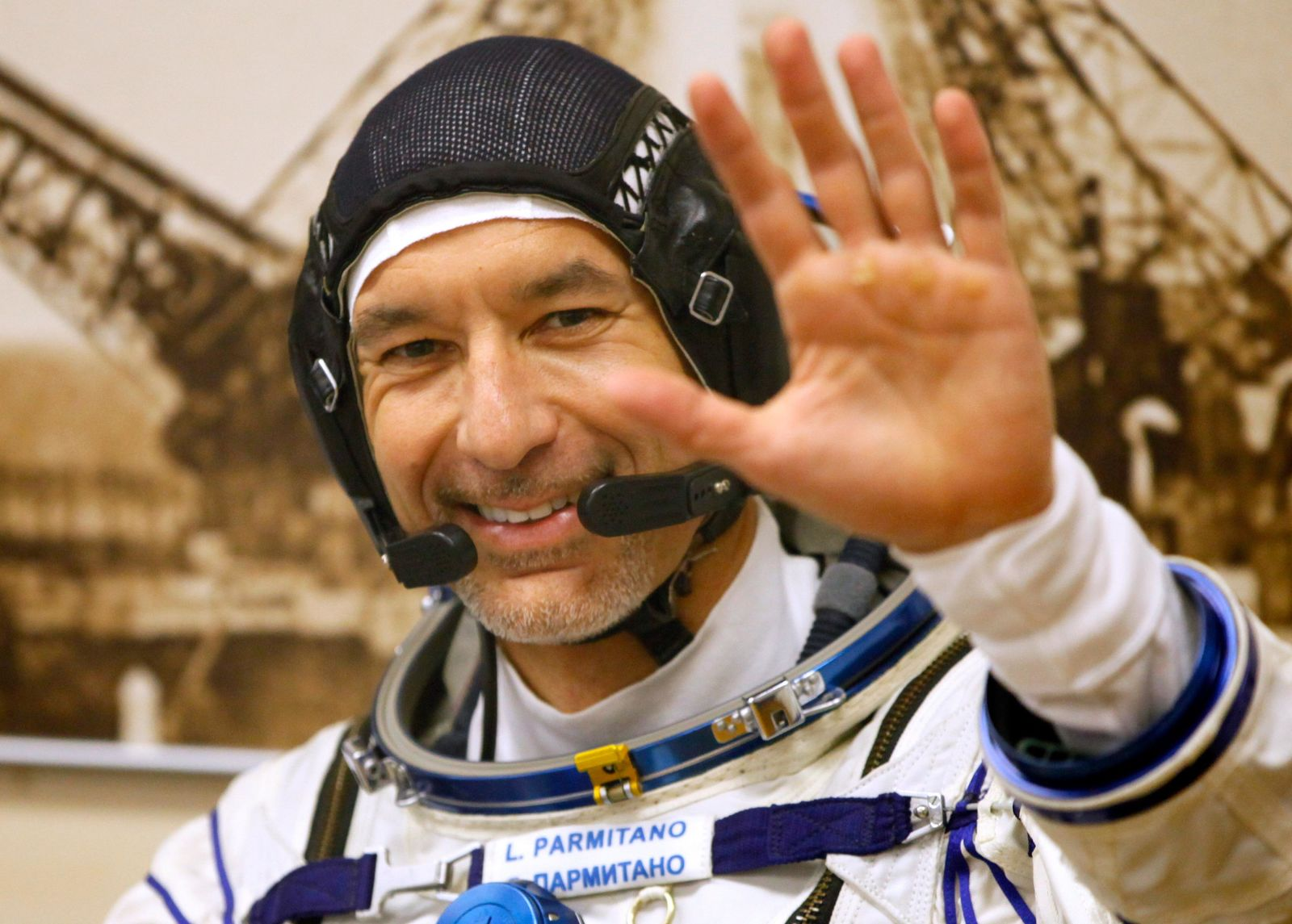 Italian astronaut Luca Parmitano, member of the main crew of the expedition to the International Space Station (ISS), gestures prior the launch of Soyuz MS-13 space ship at the Russian leased Baikonur cosmodrome, Kazakhstan, Saturday, July 20, 2019. (AP Photo/Dmitri Lovetsky)