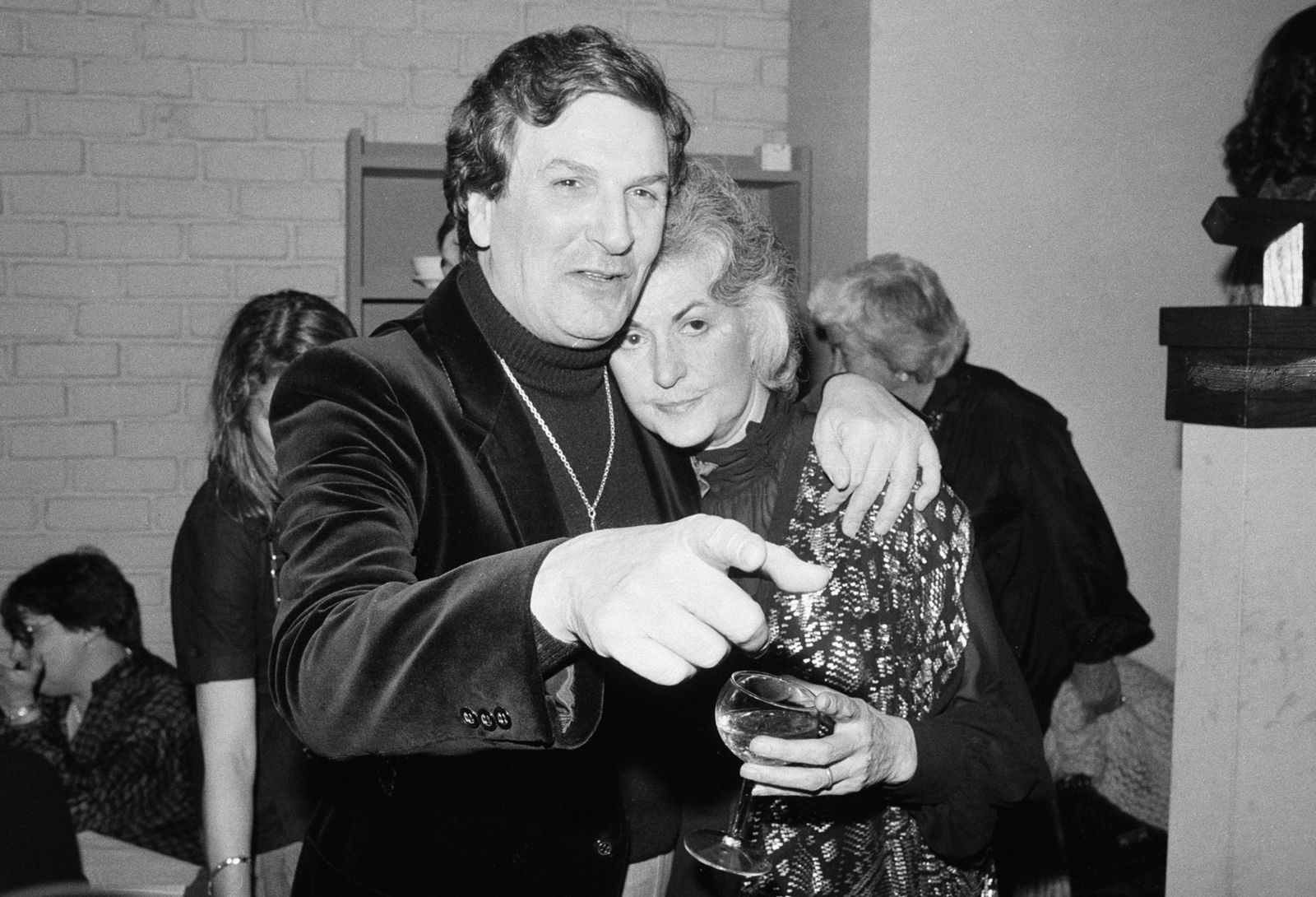 "FILE - In this April 28, 1981 file photo, Actor Danny Aiello hugs actress Beatrice Arthur at a party following their opening performance in Woody Allen's play, ""The Floating Lightbulb,"" in New York.{ } (AP Photo/Richard Drew, File)"