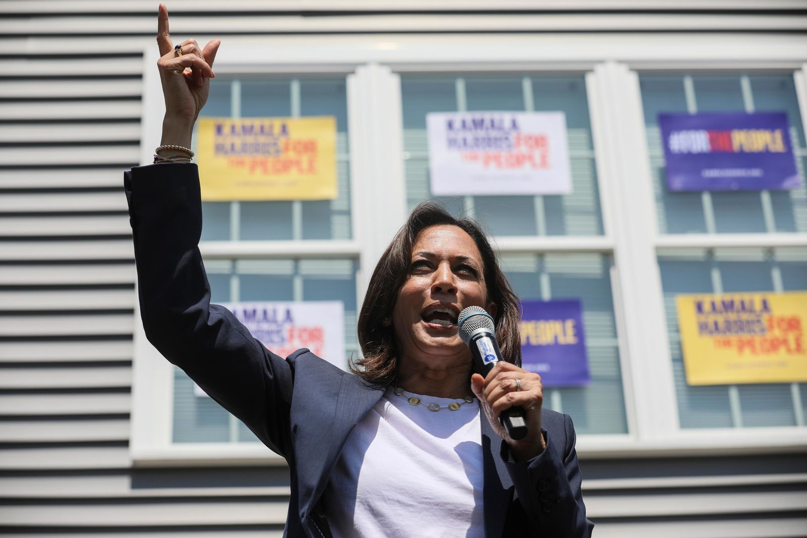 Supporters applaud as Democratic presidential candidate, U.S. Sen. Kamala Harris, D-Calif., gestures while speaking at a house party in Gilford, N.H., Sunday, July 14, 2019. (AP Photo/ Cheryl Senter)
