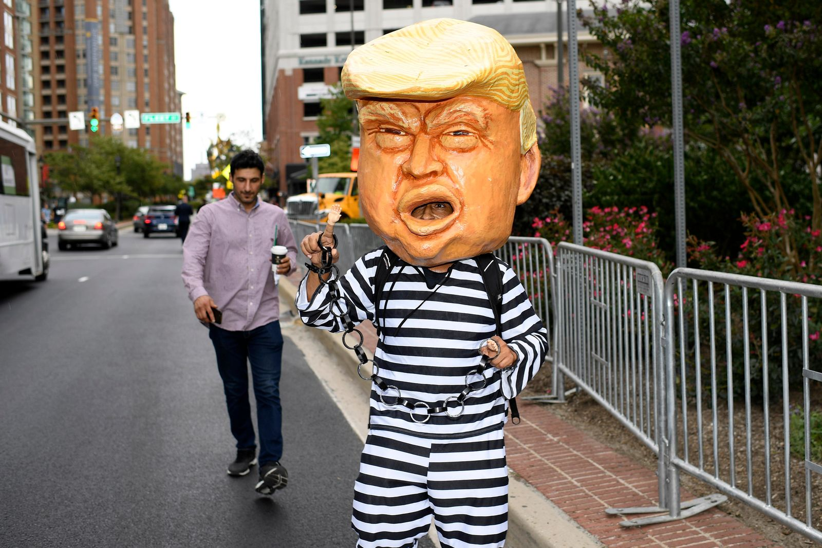 A person dressed as President Donald Trump walks near the U.S. House Republican Member Retreat, Thursday, Sept. 12, 2019, in Baltimore. (AP Photo/Nick Wass)