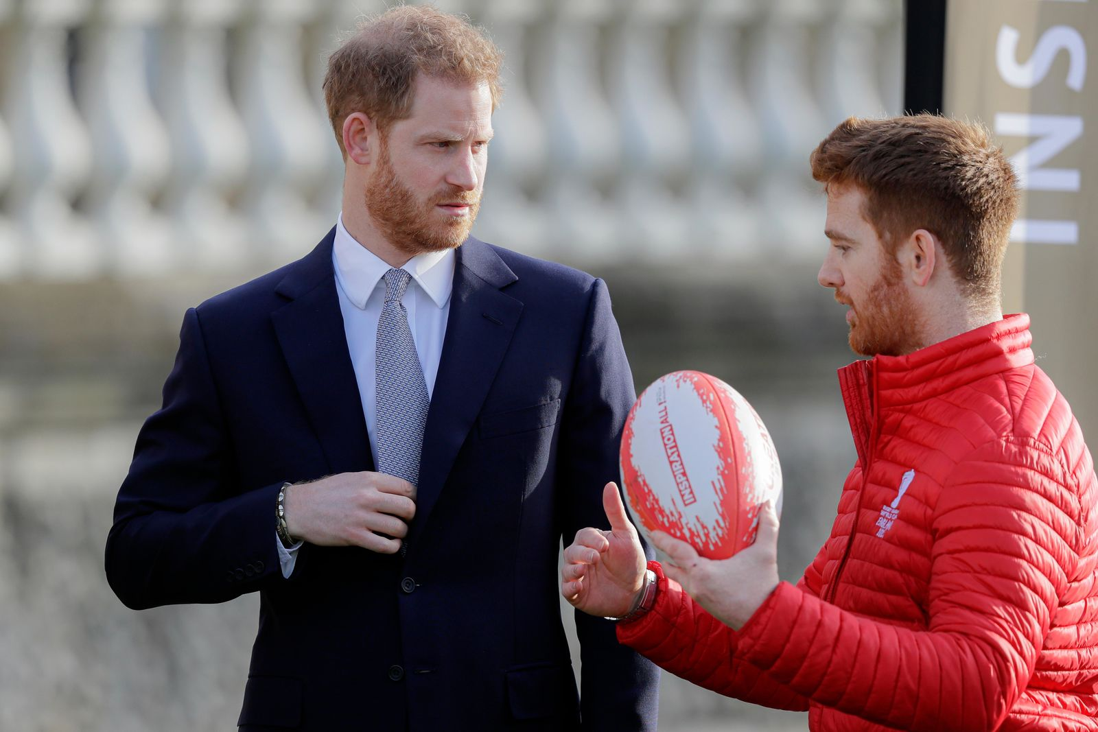 Britain's Prince Harry listens to Rugby League World Cup 2021 (RLWC2021) ambassador James Simpson in the gardens at Buckingham Palace in London, Thursday, Jan. 16, 2020 (AP Photo/Kirsty Wigglesworth)