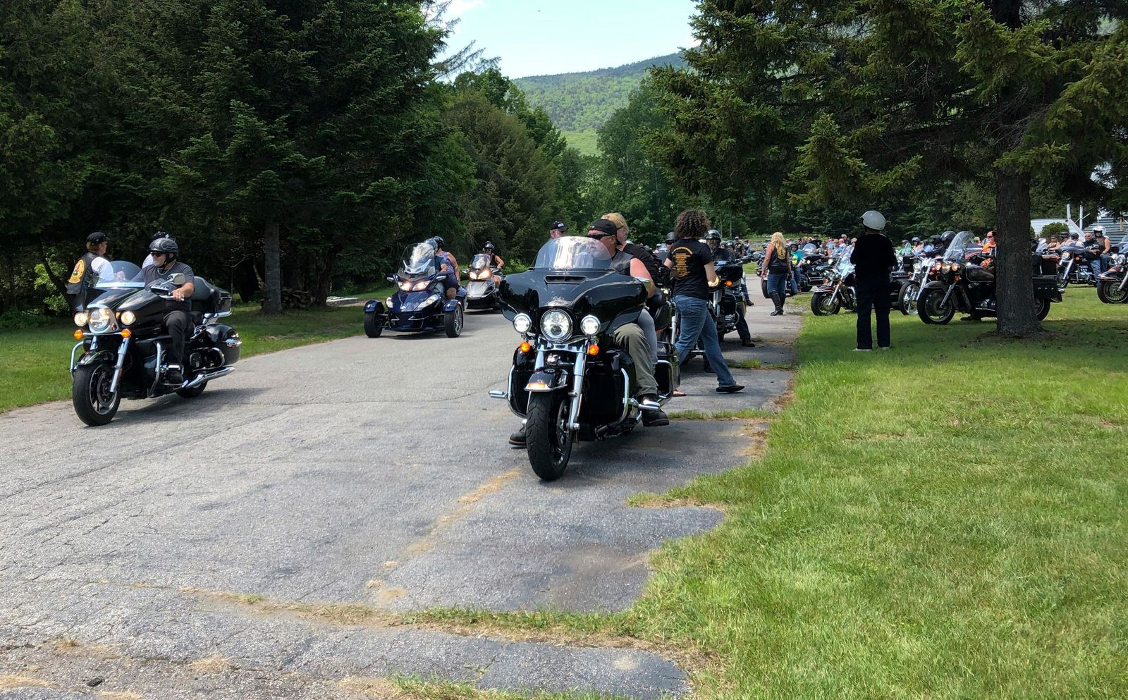 "Motorcyclists participate in a ""Blessing of the Bikes"" ceremony in Columbia, N.H., Sunday, June 23, 2019. While such ceremonies are periodically held, the Sunday event held special meaning for the motorcycle community. Bikers and veterans are reeling from a crash, in which a pickup truck towing a flatbed trailer collided with a group of 10 motorcycles Friday evening. (AP Photo/Lisa Rathke)"