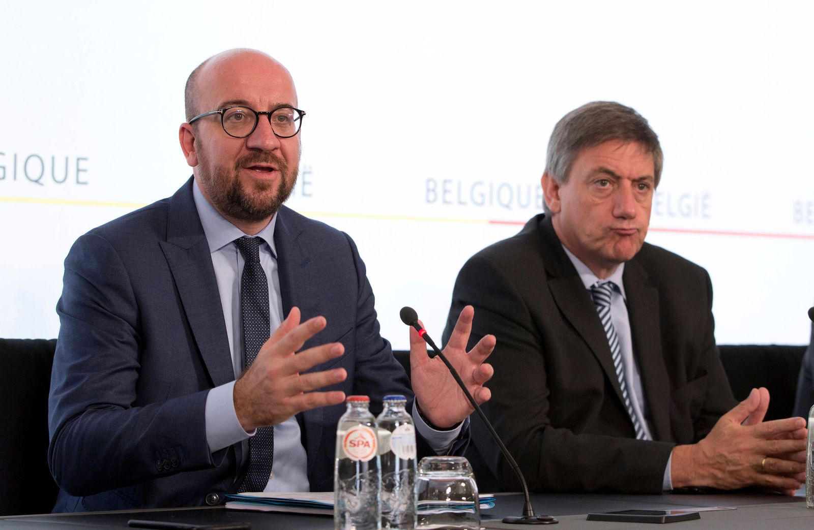 In this June 21, 2017 file photo, Belgian Prime Minister Charles Michel, left, and Belgium's Interior Minister and the N-VA's top official in the government Jan Jambon address the media during a press conference at the prime ministers office in Brussels. (AP Photo/Virginia Mayo)