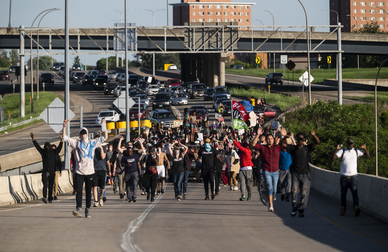 Protesters march down a highway off-ramp on May 28, 2020 on their way to Minneapolis, Minnesota. (Photo by Stephen Maturen/Getty Images)