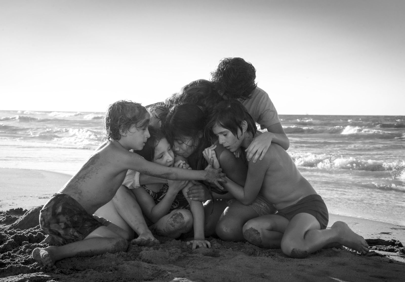 "This image released by Netflix shows Yalitza Aparicio, center, in a scene from the film ""Roma,"" by filmmaker Alfonso Cuaron. The film is nominated for an Oscar for both best foreign language film and best picture. The 91st Academy Awards will be held on Sunday. (Carlos Somonte/Netflix via AP)"