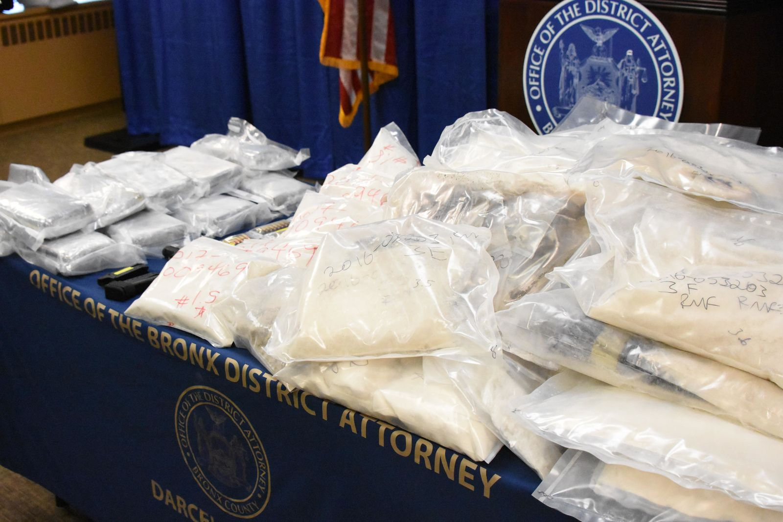 China announced Monday it will control all fentanyl products as controlled substances. This July 2, 2018 photo shows packages of heroin and fentanyl seized by the New York Fire Department. a U.S. law enforcement official handles a bag of powdered fentanyl. (Photo: DEA.gov)
