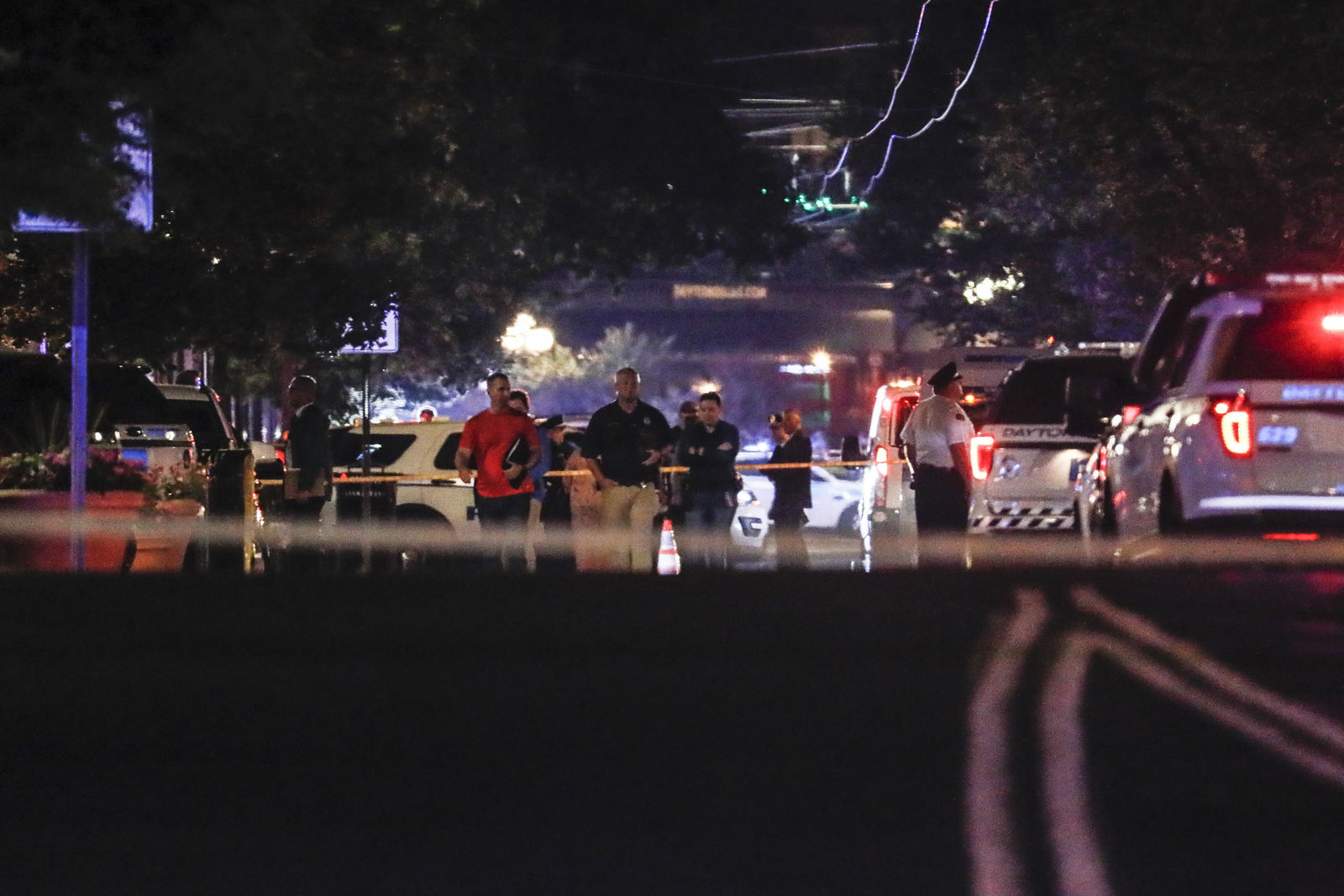 Authorities work the scene of a mass shooting, Sunday, Aug. 4, 2019, in Dayton, Ohio. A several people in Ohio have been killed in the second mass shooting in the U.S. in less than 24 hours, and the suspected shooter is also deceased, police said. (AP Photo/John Minchillo)