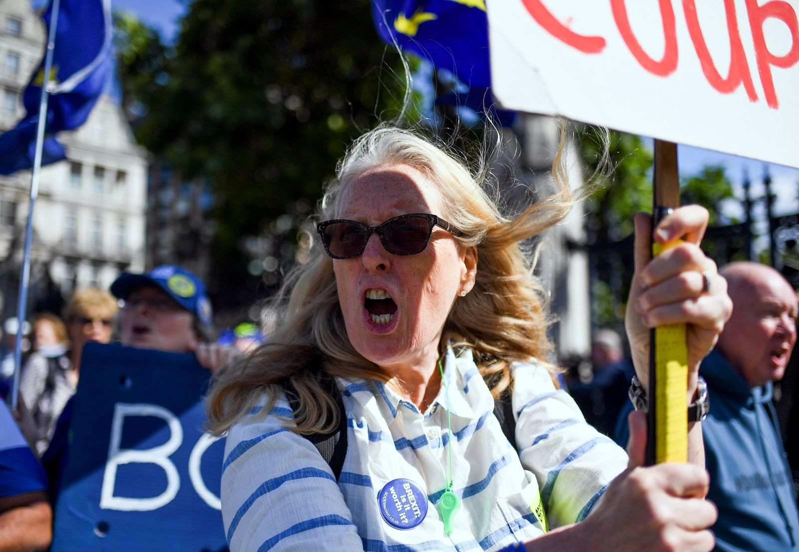 Anti-Brexit demonstrators attend a protest outside the Houses of Parliament, in London, Wednesday, Sept. 4, 2019. A Scottish court says British Prime Minister Boris Johnson's planned suspension of Parliament is lawful. It is the first of several challenges to Johnson's maneuver that gives lawmakers little time to prevent Britain from crashing out of the European Union without an agreement on Oct. 31. (AP Photo/Alberto Pezzali)