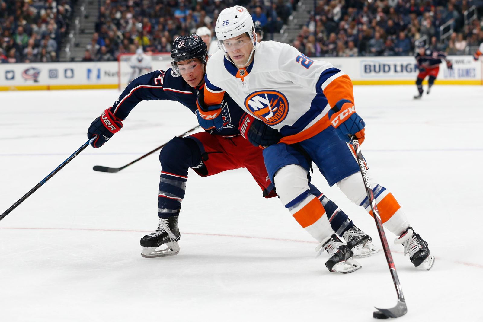 New York Islanders' Oliver Wahlstrom, right, carries the puck past Columbus Blue Jackets' Sonny Milano during the first period of an NHL hockey game Saturday, Oct. 19, 2019, in Columbus, Ohio. (AP Photo/Jay LaPrete)