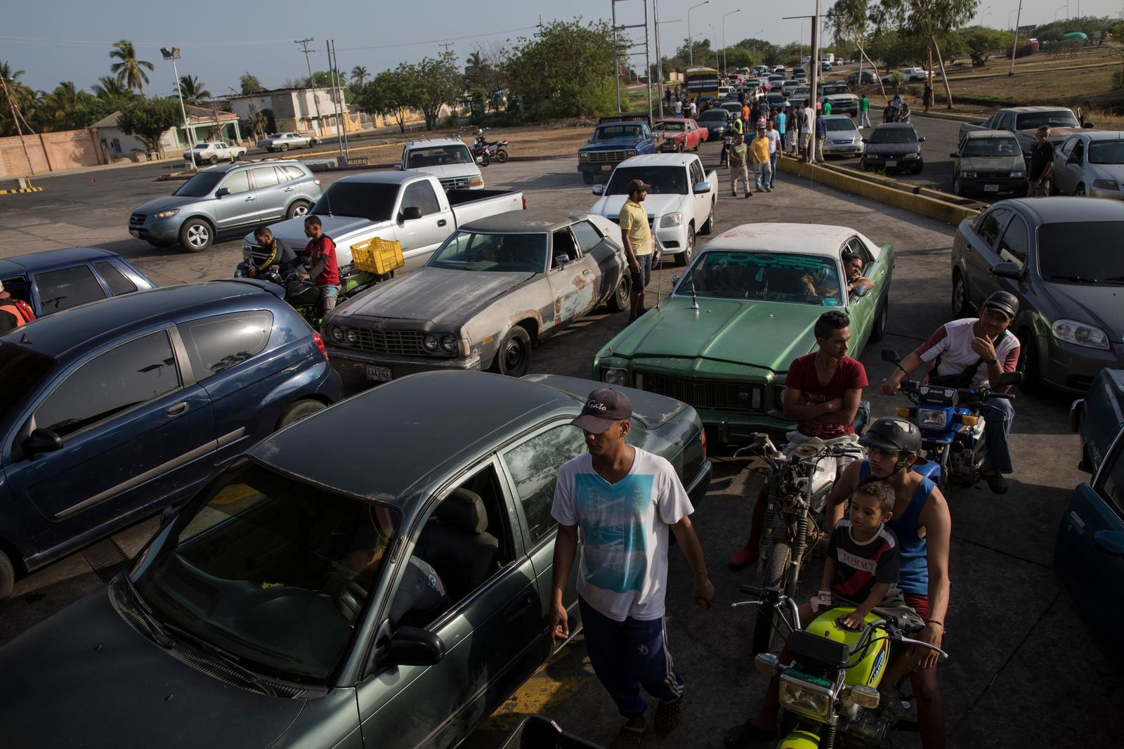 A line of cars spills on to the street as drivers wait to fill their tanks at a fuel station in Cabimas, Venezuela, Sunday, May 15, 2019.{ } (AP Photo/Rodrigo Abd)