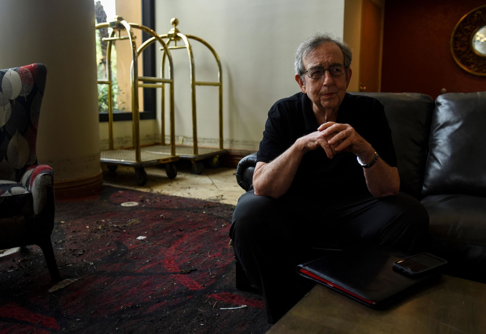 MCM Elegante manager Bill Bianchi talks about the flooding that affected up to two feet of the first floor of the hotel in Beaumont, Texas, Friday, Sept. 20, 2019. The heaviest rainfall had ended by Thursday night in Southeast Texas, but forecasters warned that parts of northeast Texas, Arkansas, Oklahoma and Louisiana could see flash flooding as Imelda's remnants shifted to the north. (Ryan Welch/The Beaumont Enterprise via AP)