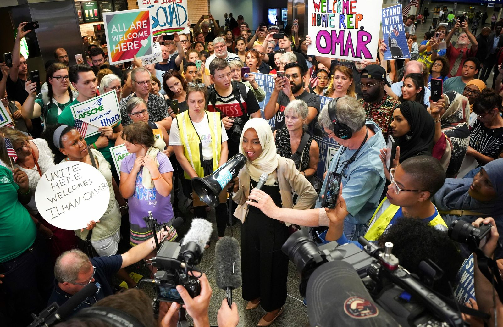 U.S. Rep. Ilhan Omar speaks to supporters after arriving home, at Minneapolis–Saint Paul International Airport, Thursday, July 18, 2019, in Minnesota. (Glen Stubbe/Star Tribune via AP)