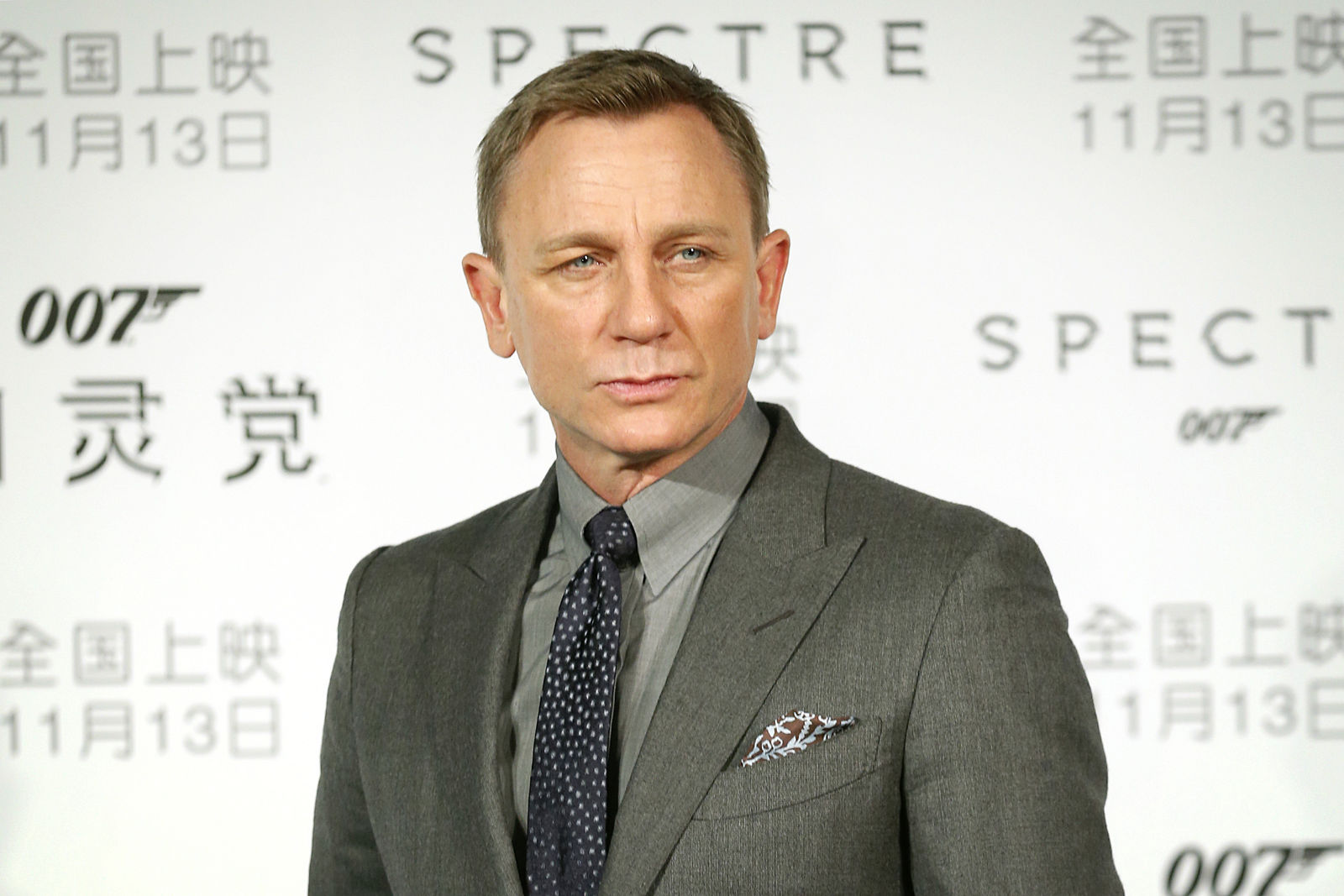 "FILE - In this Nov. 10, 2015 file photo, British actor Daniel Craig poses for photographers before a press conference for the James Bond franchise movie ""Spectre"" in Beijing.(AP Photo/Mark Schiefelbein, File)"
