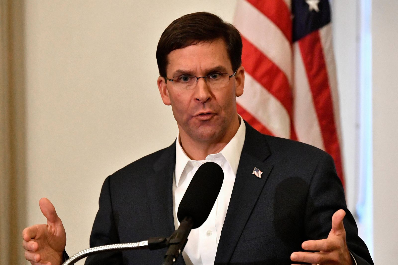 FILE - In this Friday, Oct. 4, 2019 file photo, Defense Secretary Mark Esper speaks to a gathering of soldiers at the University Club at the University of Louisville in Louisville, Ky. Esper says during a weekend trip to the Middle East that under the current plan all U.S. troops leaving Syria will go to western Iraq, and that the military will continue to conduct operations against the Islamic State group to prevent a resurgence in that country. As Esper left Washington on Saturday, Oct. 19, U.S. troops were continuing to pull out of northern Syria after Turkey's invasion into the border region. (AP Photo/Timothy D. Easley, File)