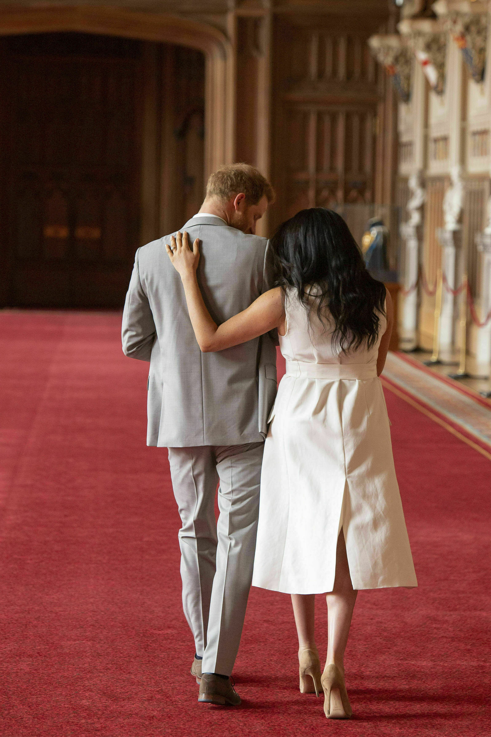 FILE - In this Wednesday May 8, 2019 file photo Britain's Prince Harry and Meghan, Duchess of Sussex, leave after a photo call with their newborn son, in St George's Hall at Windsor Castle, Windsor, south England. Prince Harry and Meghan Markle are to no longer use their HRH titles and will repay £2.4 million of taxpayer's money spent on renovating their Berkshire home, Buckingham Palace announced Saturday, Jan. 18. 2020. (Dominic Lipinski/Pool via AP, File)