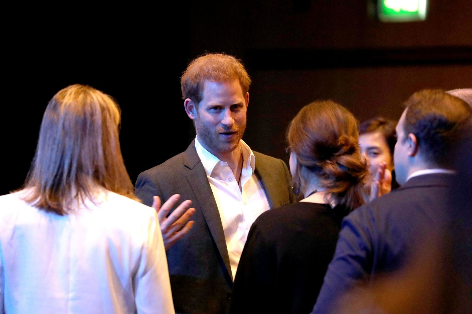 Britain's Prince Harry, centre, speaks, during a sustainable tourism summit at the Edinburgh International Conference Centre in Edinburgh, Scotland, Wednesday, Feb. 26, 2020. (Andrew Milligan/Pool Photo via AP)