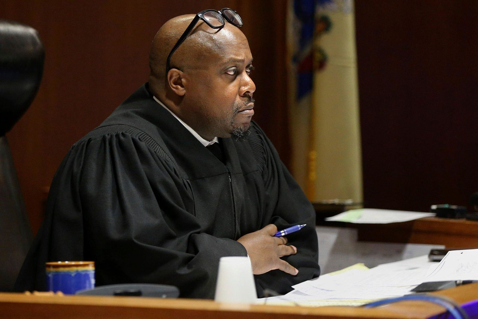 Judge Terrence Cook listens as Mark D'Amico pleads guilty to one count of misappropriating entrusted funds in Burlington County Superior Court in Mount Holly, N.J., on Friday, Dec. 6, 2019. (Tim Tai/The Philadelphia Inquirer via AP)