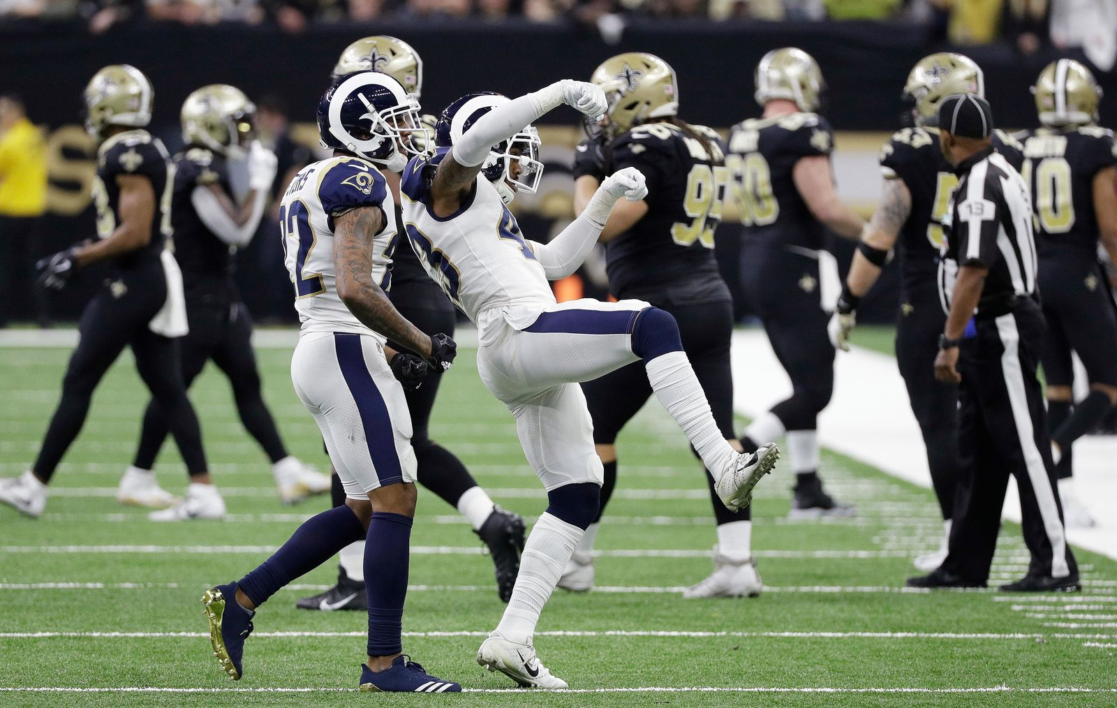 Los Angeles Rams strong safety John Johnson (43) and team mates celebrate during overtime of the NFL football NFC championship game against the New Orleans Saints, Sunday, Jan. 20, 2019, in New Orleans. (AP Photo/David J. Phillip)
