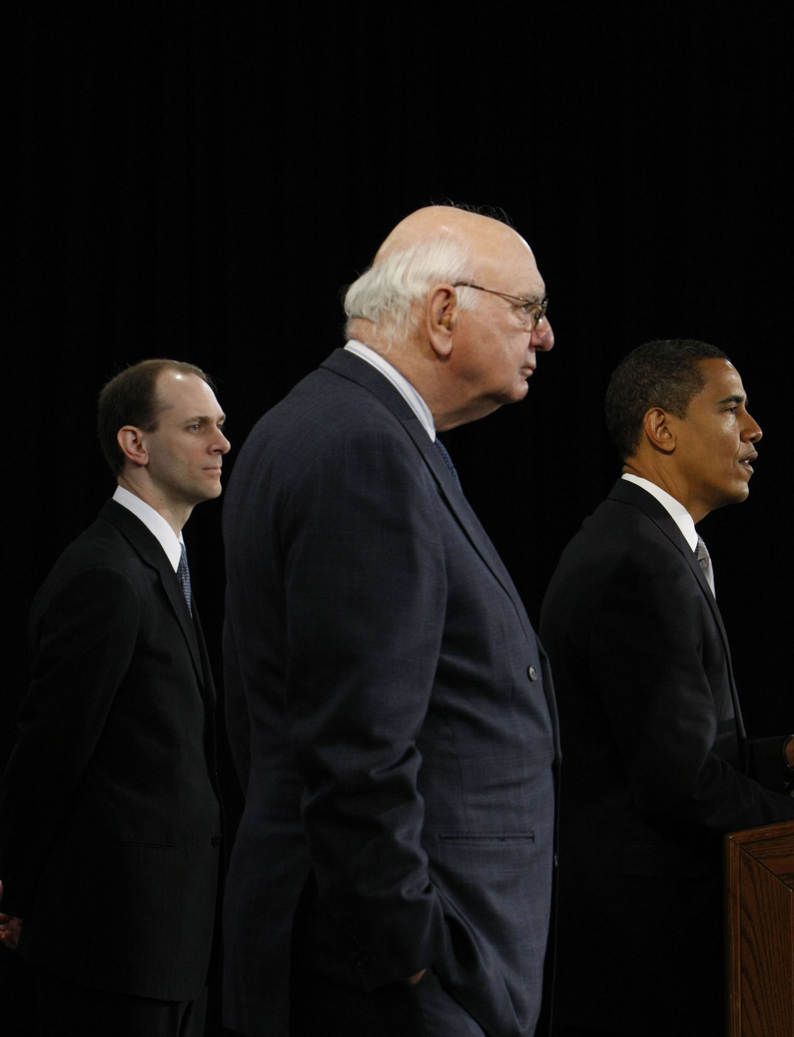 FILE - In this Nov. 26, 2008, file photo President-elect Barack Obama, right, stands with former Federal Reserve Chairman Paul Volcker, chairman-designate of the Economic Recovery Advisory Board, center, and chief economist-designate Austan Goolsbee, left, as he speaks at a news conference in Chicago. (AP Photo/Pablo Martinez Monsivais, File)