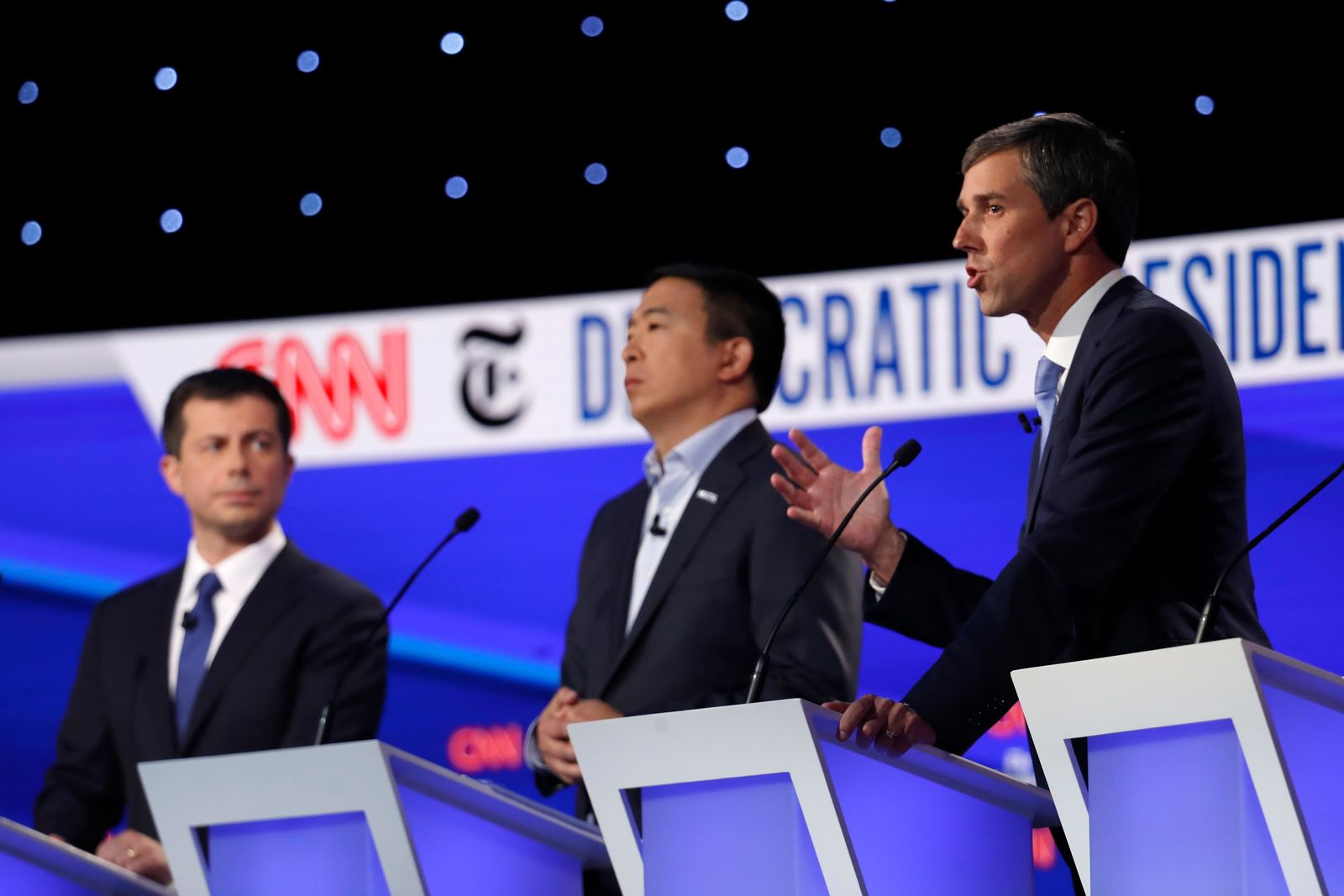 Democratic presidential candidate former Texas Rep. Beto O'Rourke, right, speaks as Democratic presidential candidate entrepreneur Andrew Yang, center and Democratic presidential candidate and South Bend Mayor Pete Buttigieg listen during a Democratic presidential primary debate hosted by CNN/New York Times at Otterbein University, Tuesday, Oct. 15, 2019, in Westerville, Ohio. (AP Photo/John Minchillo)