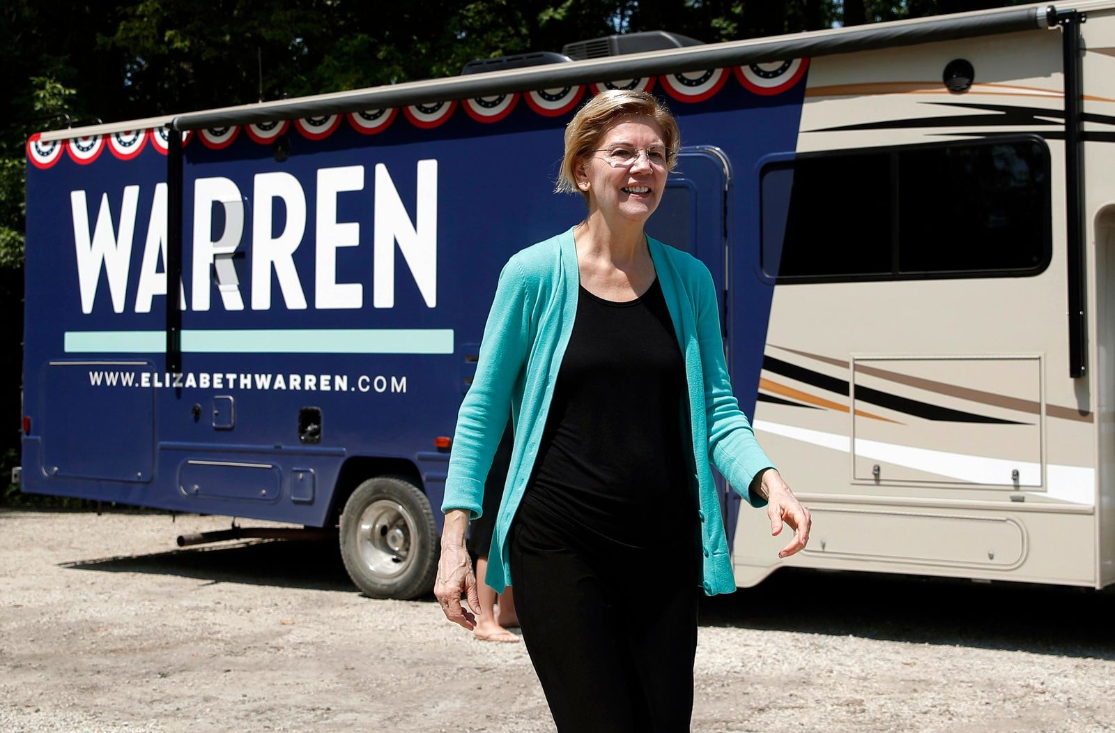 Democratic presidential candidate Sen. Elizabeth Warren, D-Mass., exits a motor home as she visits a park along the Des Moines River, Friday, Aug. 9, 2019, in Humboldt, Iowa. (AP Photo/John Locher)