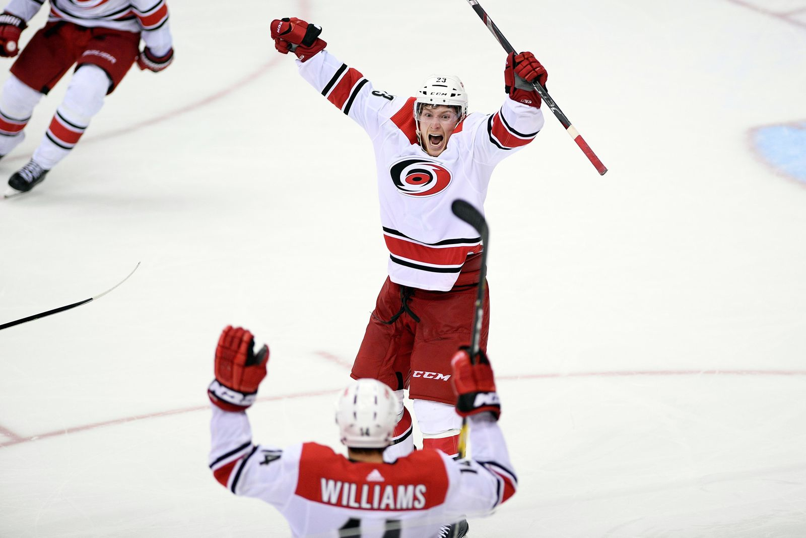Carolina Hurricanes left wing Brock McGinn (23) celebrates his game-winning goal with Justin Williams (14) in double overtime of Game 7 of an NHL hockey first-round playoff series against the Washington Capitals, Wednesday, April 24, 2019, in Washington. The Hurricanes won 4-3 in double overtime. (AP Photo/Nick Wass)