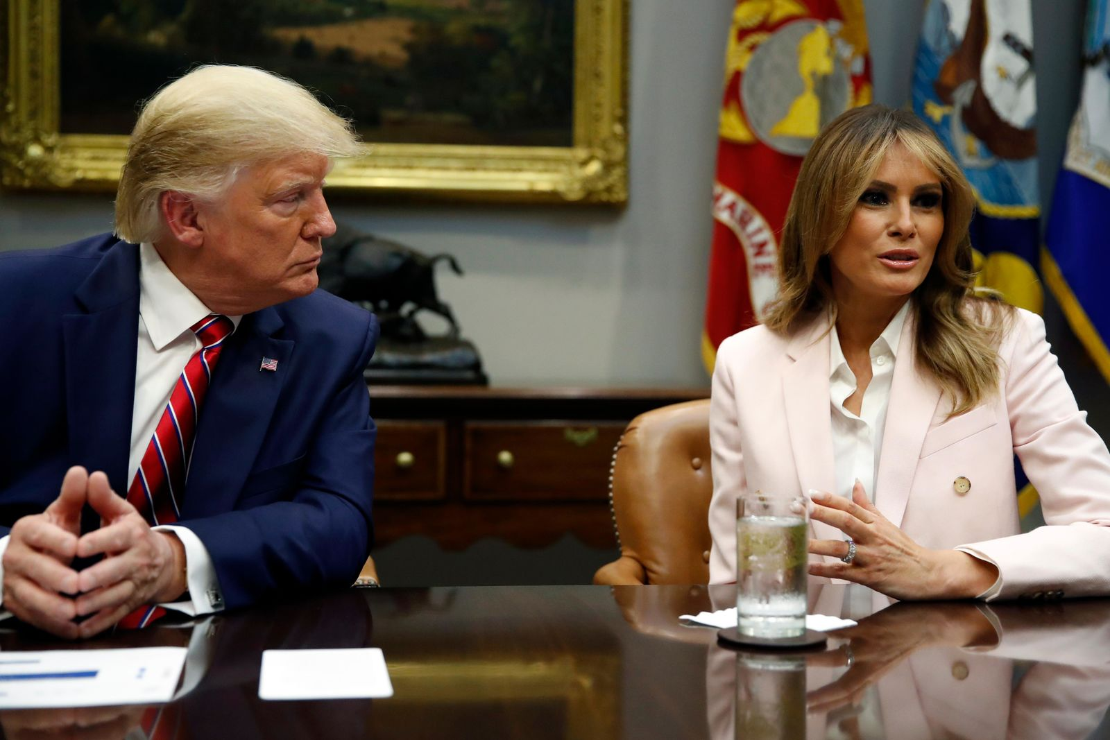 President Donald Trump listens as first lady Melania Trump speaks during a briefing on efforts to combat the opioid crisis in the Roosevelt Room of the White House, Wednesday, June 12, 2019, in Washington. (AP Photo/Alex Brandon)