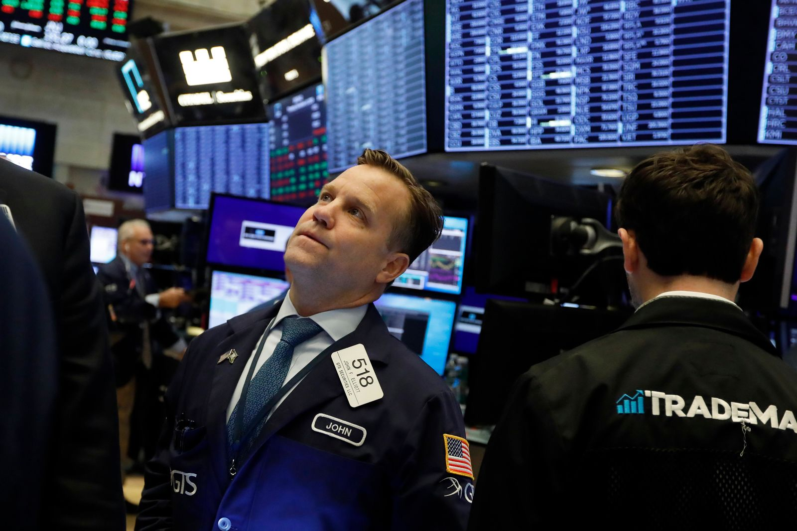 FILE - In this Nov. 14, 2019, file photo trader John Elliott works on the floor of the New York Stock Exchange. The U.S. stock market opens at 9:30 a.m. EST on Tuesday, Dec. 3. (AP Photo/Richar