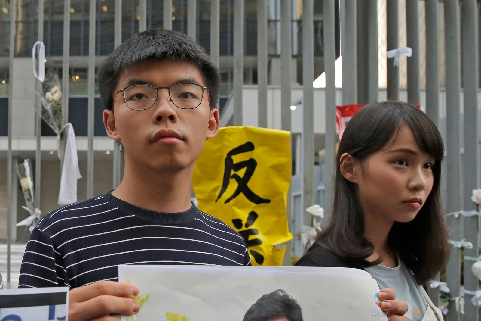 FILE - In this June 18, 2019, file photo, pro-democracy activists Agnes Chow, right, and Joshua Wong speak to the media outside government office in Hong Kong. (AP Photo/Kin Cheung, File)
