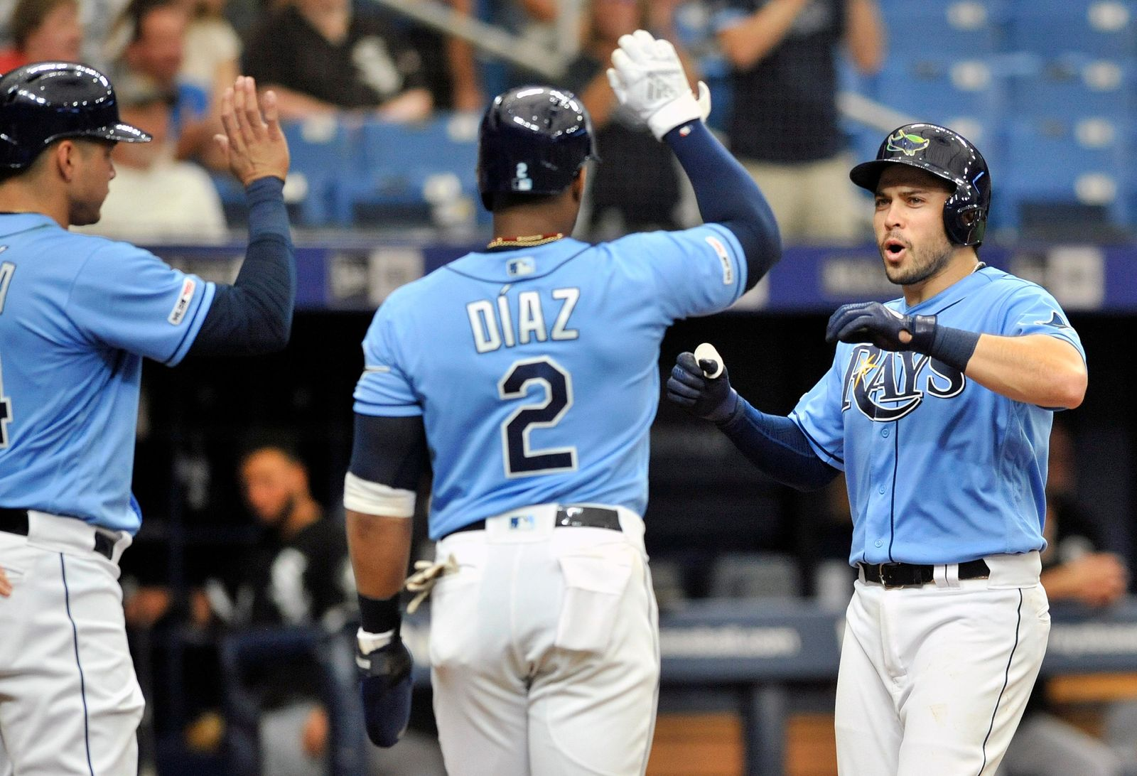 Tampa Bay Rays' Avisail Garcia, left, Yandy Diaz, center, and Travis d'Arnaud, right, celebrate d'Arnaud's grand slam off Chicago White Sox starter Dylan Cease during the second inning of a baseball game Sunday, July 21, 2019, in St. Petersburg, Fla. (AP Photo/Steve Nesius)