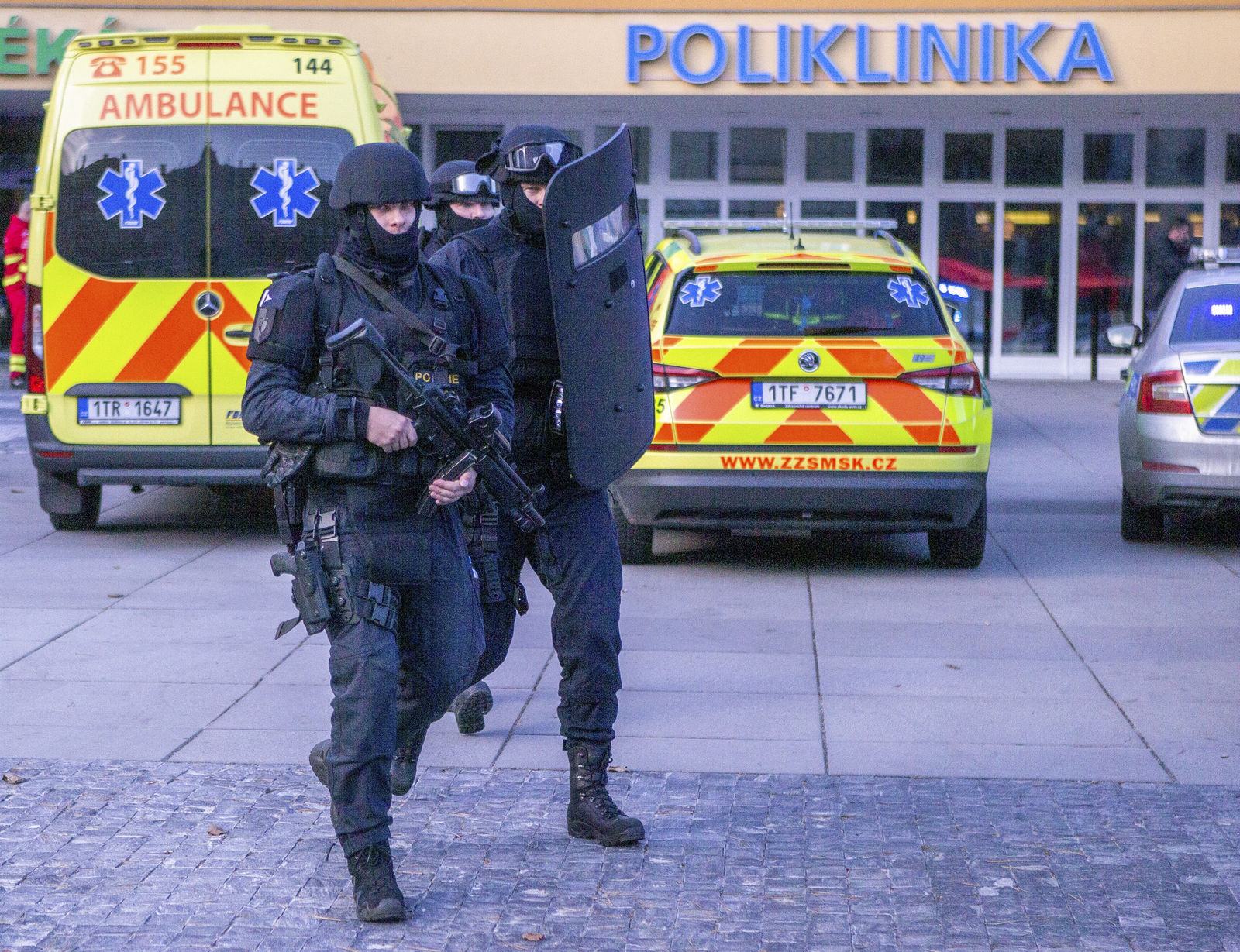 Police personnel outside the Ostrava Teaching Hospital after a shooting incident in Ostrava, Czech Republic, Tuesday, Dec. 10, 2019. . (Vladimir Prycek/CTK via AP)