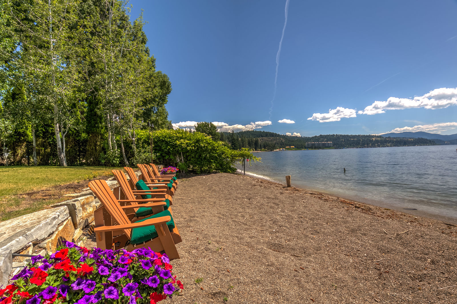 1102 E Lakeshore Dr is located in Coeur d'Alene and features a private dock and sandy beach. The cost?Just $3.95 million!{ } There is even a wine room and cellar perfect for a lake retreat. For more information contact Pearl Realty at 208.762.5500 or 9235 N Government Way Hayden, ID 83835
