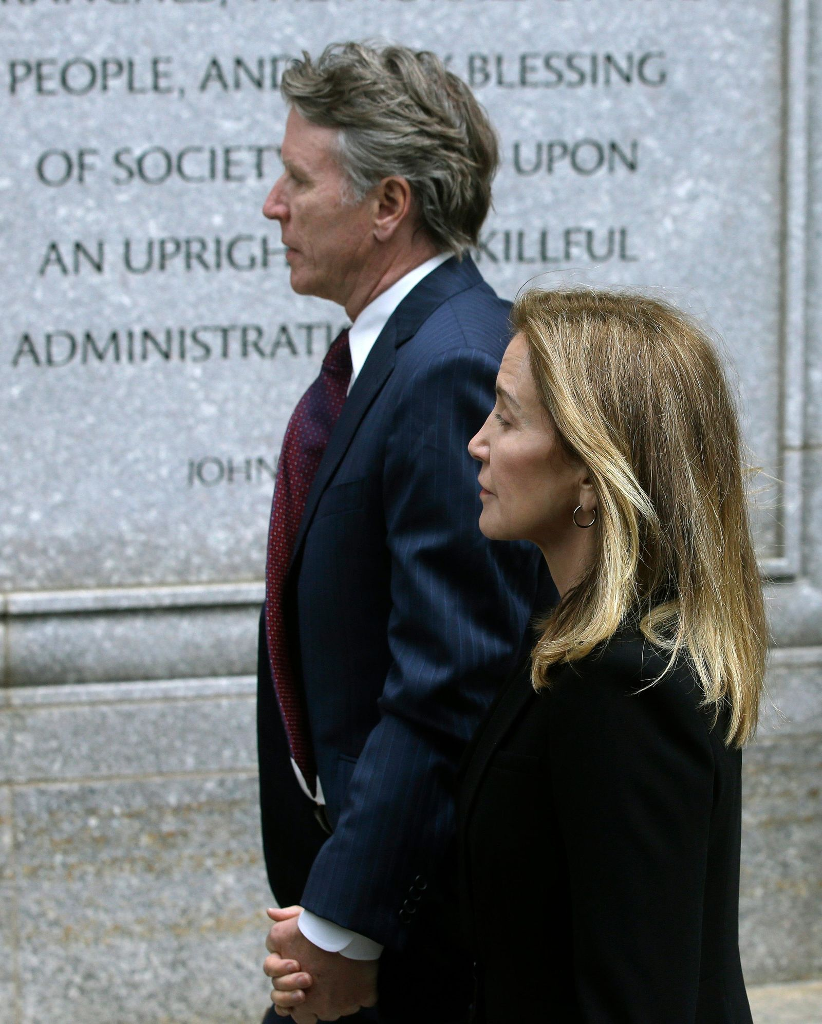 Actress Felicity Huffman arrives with her brother Moore Huffman Jr., at federal court Monday, May 13, 2019, in Boston, where she is scheduled to plead guilty to charges in a nationwide college admissions bribery scandal. (AP Photo/Steven Senne)