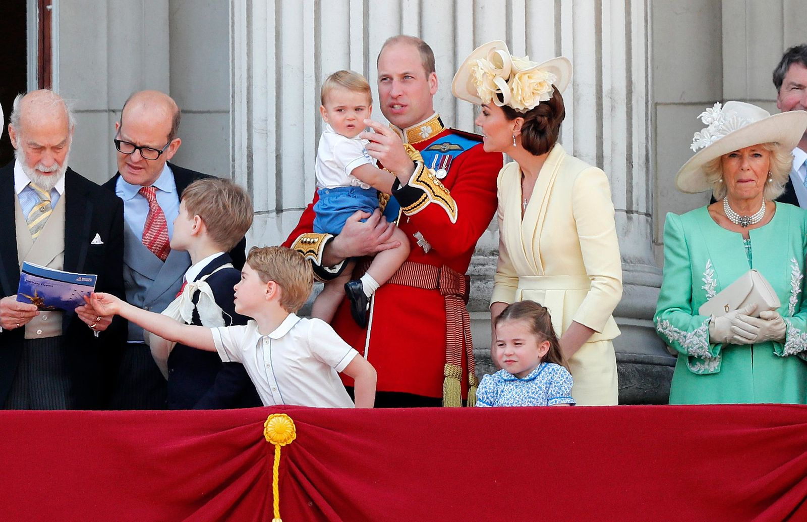 Britain's Prince William and Kate, the Duchess of Cambridge with their Prince George, center left, Princess Charlotte, center right, and Prince Louis, top center, attend the annual Trooping the Colour Ceremony in London, Saturday, June 8, 2019. Trooping the Colour is the Queen's Birthday Parade and one of the nation's most impressive and iconic annual events attended by almost every member of the Royal Family. (AP Photo/Frank Augstein)