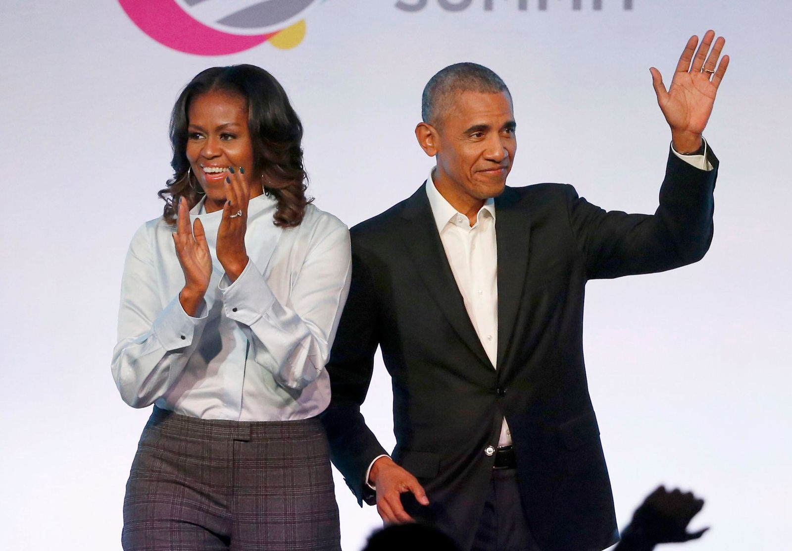 FILE - In this Oct. 31, 2017 file photo, former President Barack Obama, right, and former first lady Michelle Obama appear at the Obama Foundation Summit in Chicago. (AP Photo/Charles Rex Arbogast, File)