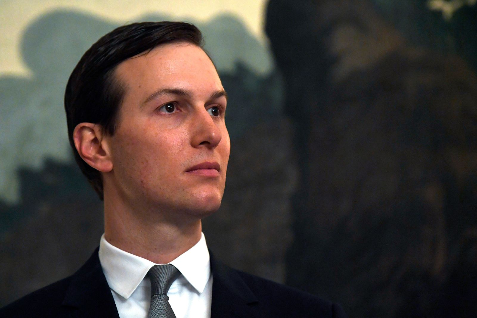 FILE - In this March 25, 2019, file photo White House adviser Jared Kushner listens during a proclamation signing with President Donald Trump and Israeli Prime Minister Benjamin Netanyahu in the Diplomatic Reception Room at the White House in Washington. Kushner will present the economic portion of his Mideast peace plan on June 25 in Bahrain, with some key players missing. (AP Photo/Susan Walsh, File)