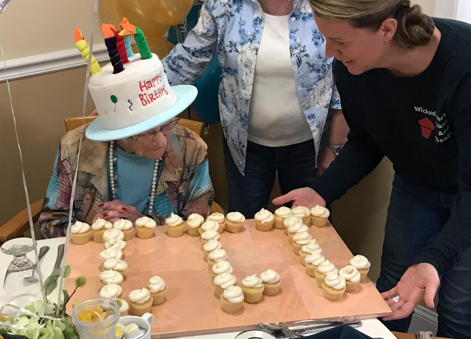 In this photo provided by Tony Venti, Hazel Nilson celebrates her 111th birthday with peach cupcakes, Wednesday, Aug. 21, 2019, at Sunapee Cove in Sunapee, N.H. (Tony Venti via AP)