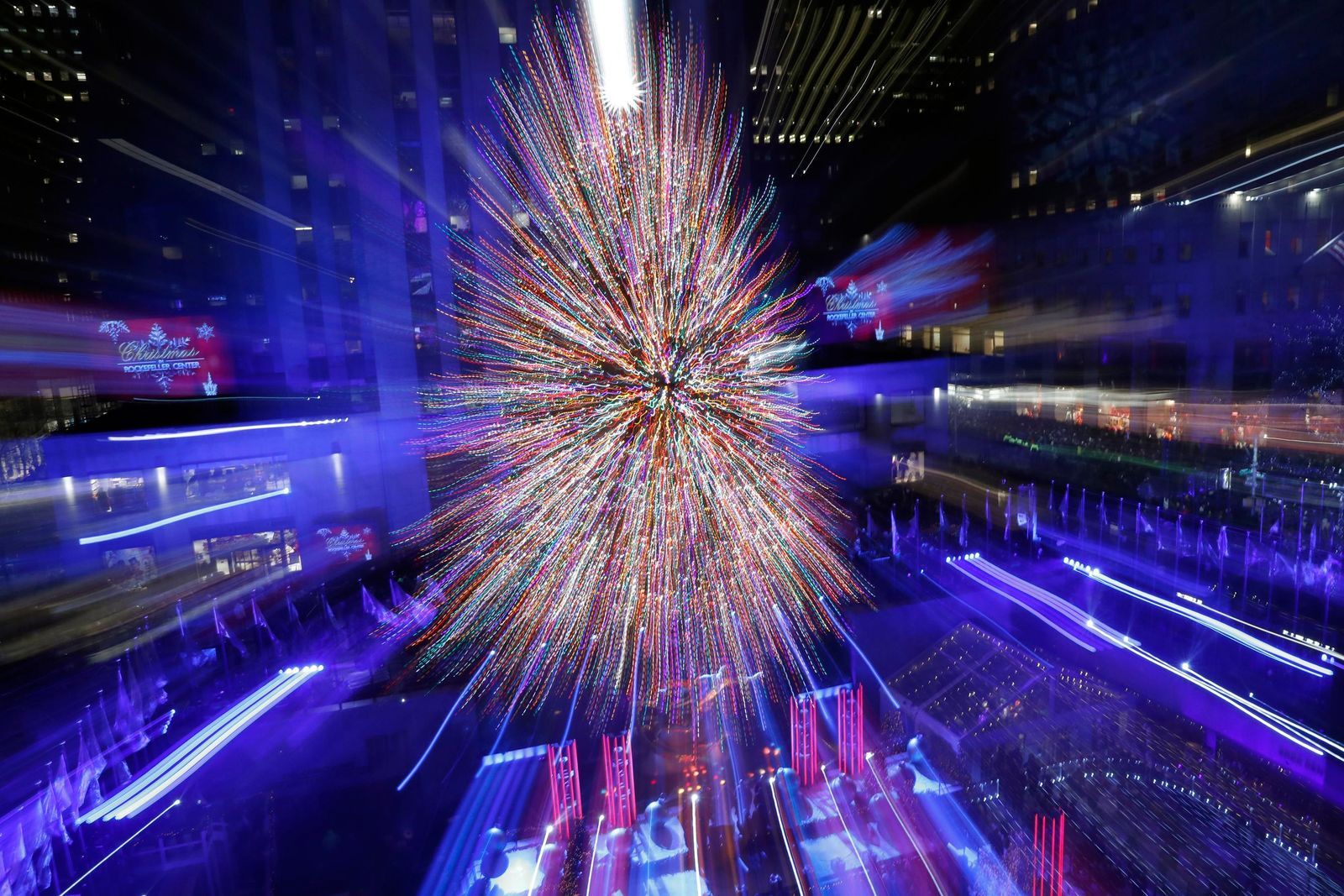 The Rockefeller Center Christmas Tree is shown in a time exposure in which the photographer's lens was zoomed at the 87th annual Rockefeller Center Christmas Tree lighting ceremony, Wednesday, Dec. 4, 2019, in New York. (AP Photo/Kathy Willens)