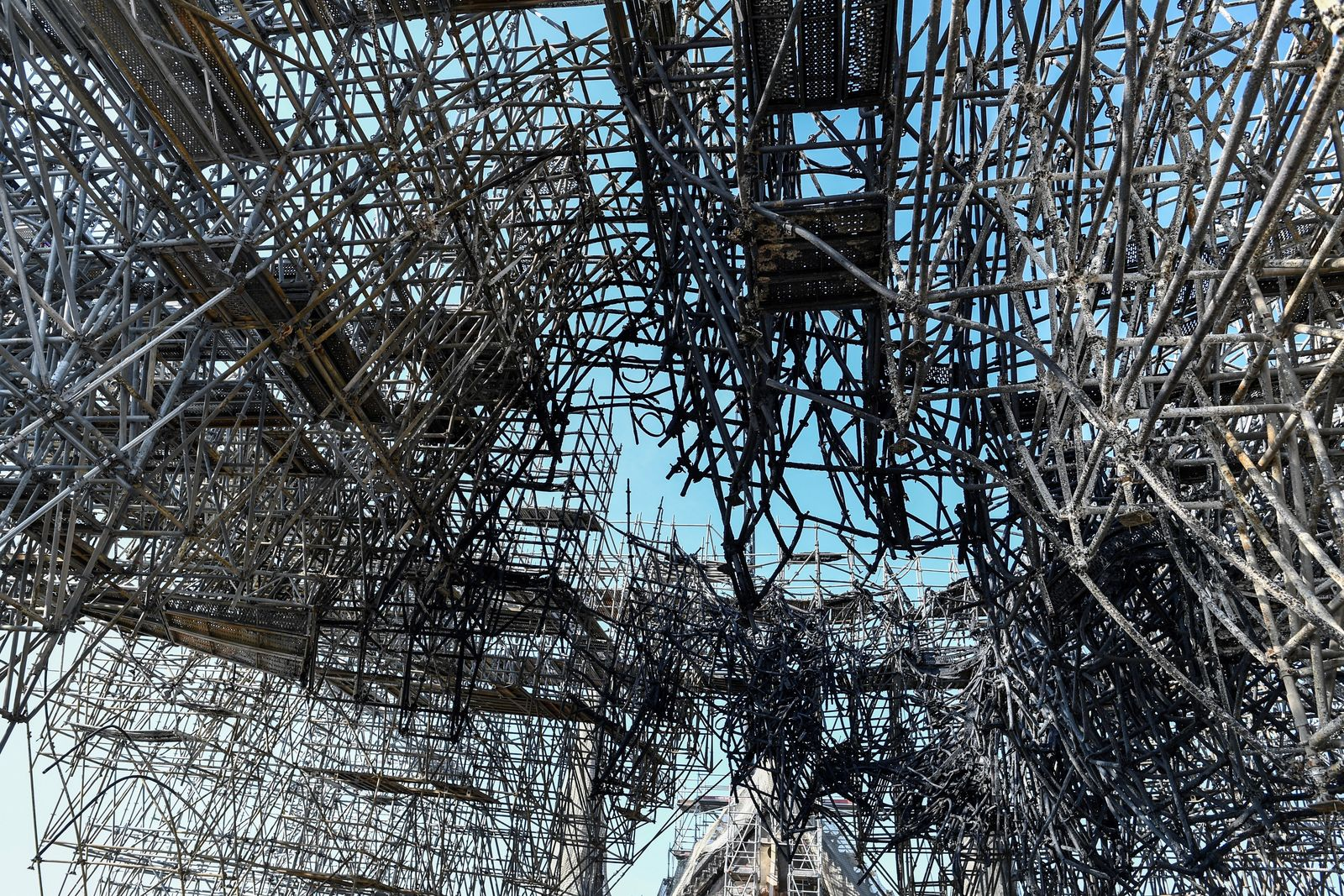 Parts of a destroyed scaffolding are pictured at the Notre-Dame de Paris Cathedral, Wednesday, July 17, 2019 in Paris.{ } (Stephane de Sakutin/Pool via AP)