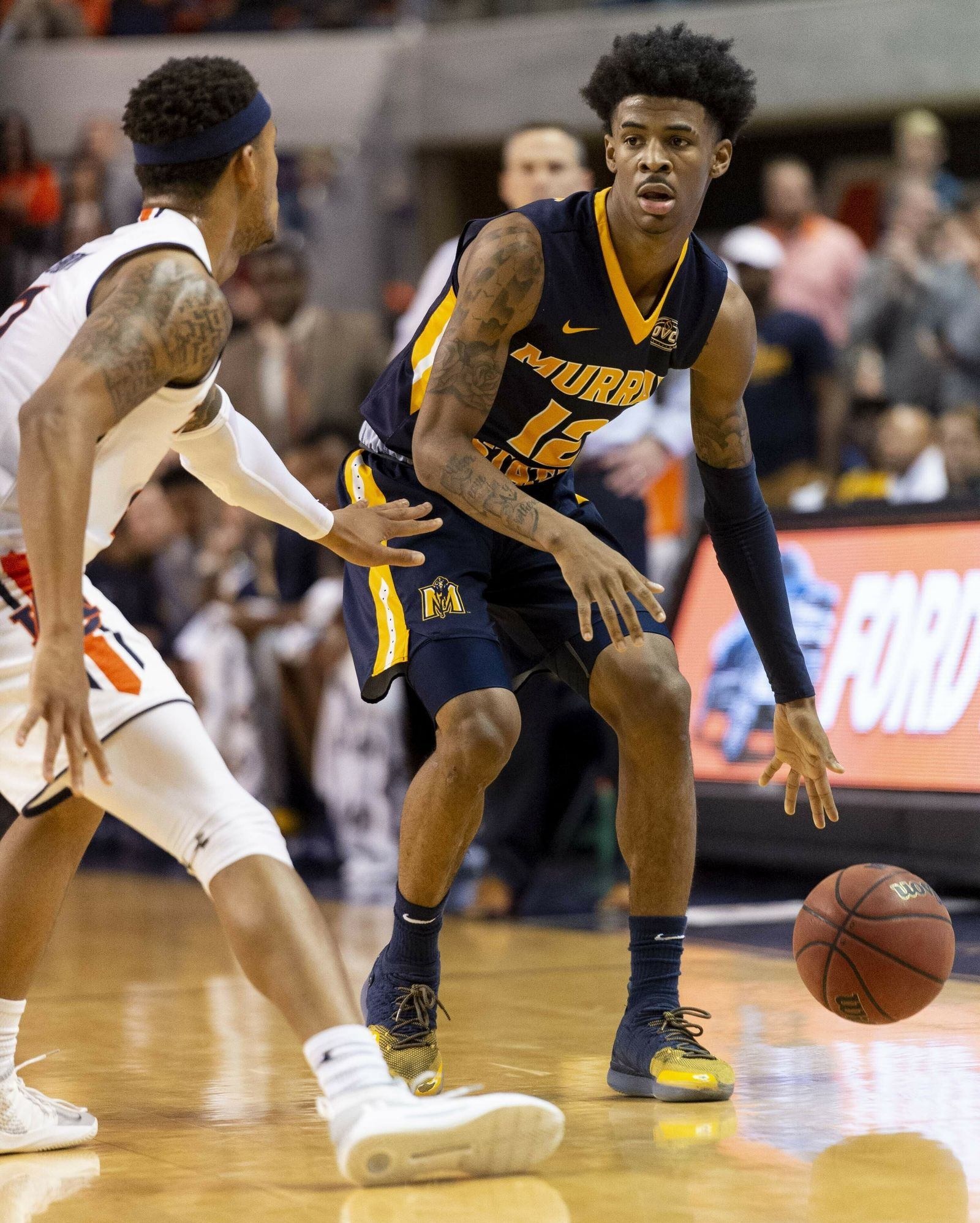 FILE - In this Dec. 22, 2018, file photo, Murray State guard Ja Morant (12) works around Auburn guard Bryce Brown (2) during the first half of an NCAA college basketball game, in Auburn, Ala. Morant, Darius Garland and Coby White make up a clear top tier of point guards in next week's NBA draft.  (AP Photo/Vasha Hunt, File)