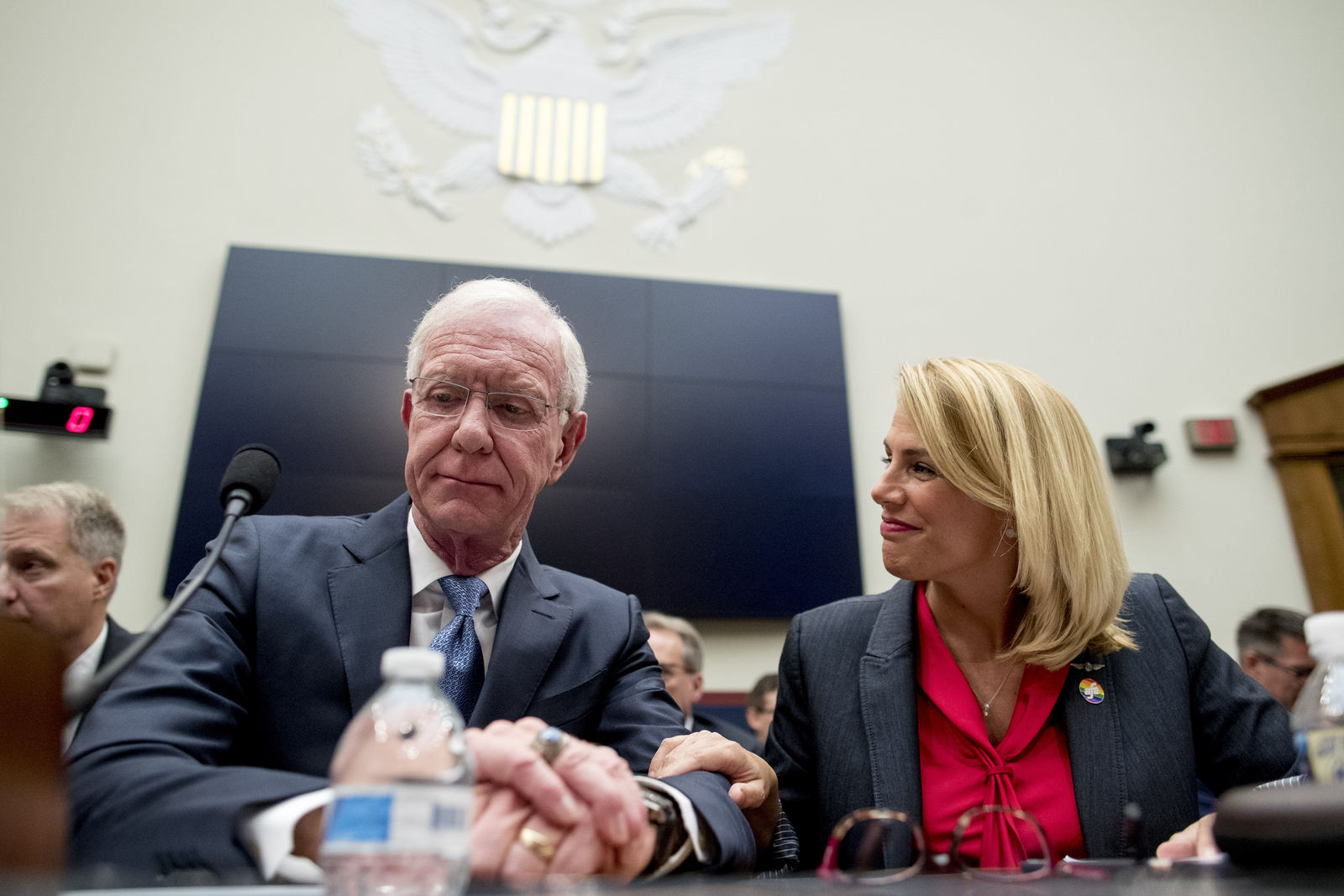 "Sara Nelson with the Association of Flight Attendants-CWA, right, speaks with Captain Chesley ""Sully"" Sullenberger left, before a House Committee on Transportation and Infrastructure hearing on the status of the Boeing 737 MAX on Capitol Hill in Washington, Wednesday, June 19, 2019. (AP Photo/Andrew Harnik)"